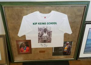 Cadillac - framed Kip Keino shirt and pictures