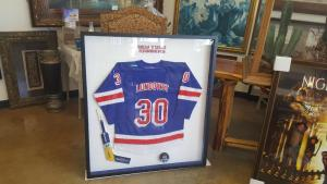Framed jersey and hockey stick